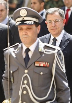 d6fa20011 Lebanese Prime Minister Fuad Saniora, right, reviews an honor guard as he  arrives at the Parliament for the election of the house speaker in Beirut,  ...